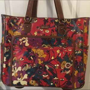 sakroots rolling suitcase bag